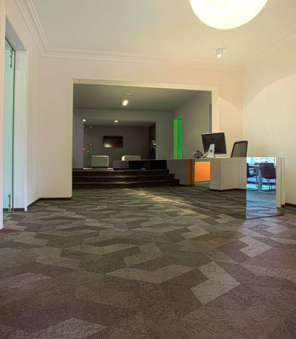 Geometric floor pattern using Bolon Studio™ tiles in the office of Born05 in Utrecht, Netherlands