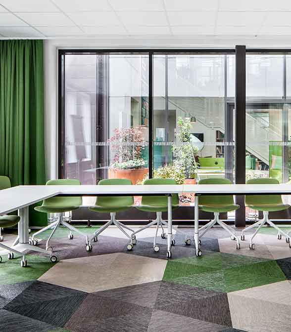 Green, grey and white hexagon floor pattern using Bolon Studio Triangle tiles in the office of Förbo in Mölnlycke, Sweden