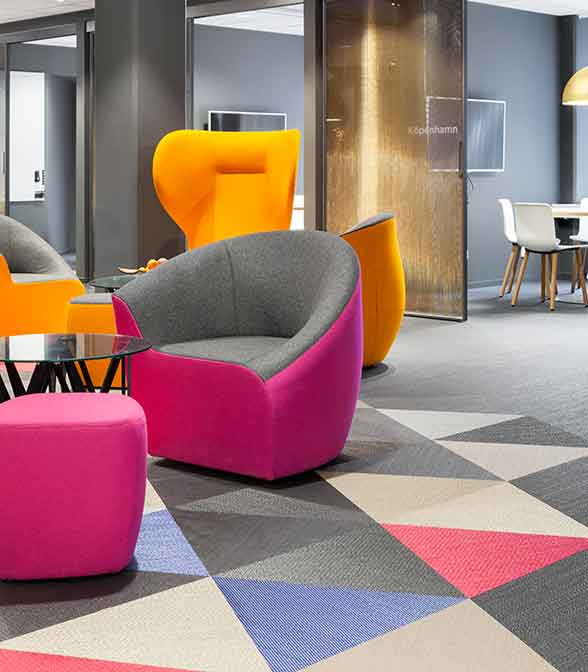Geometrical floor pattern using Bolon Studio Triangle tiles in the lounge area of SF's office in Stockholm, Sweden