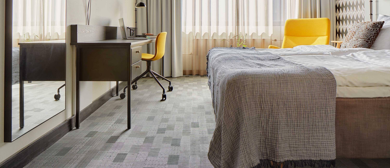 Grey checkered Bolon flooring in the rooms of Hotel Presidentti in Helsinki, Finland