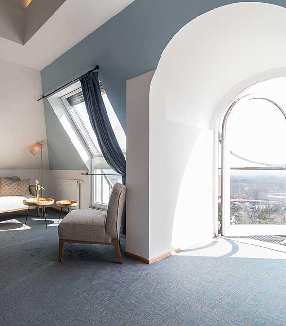 Soft blue woven vinyl flooring in the Schöne Aussicht hotel in Frankfurt, Germany