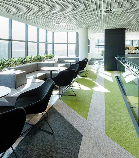 Geometrical floor pattern using resillient vinyl flooring from Bolon in the office of RMS in Sydney, Australia