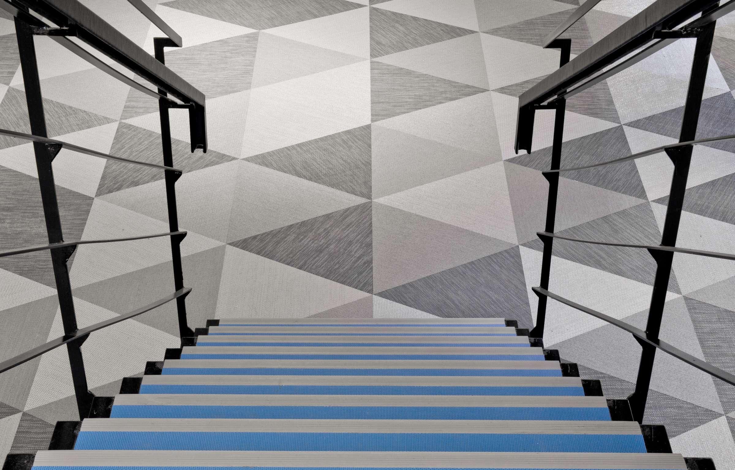 Geometric floor pattern using Bolon Studio™ Triangle tiles in the office of Skype in Stockholm, Sweden