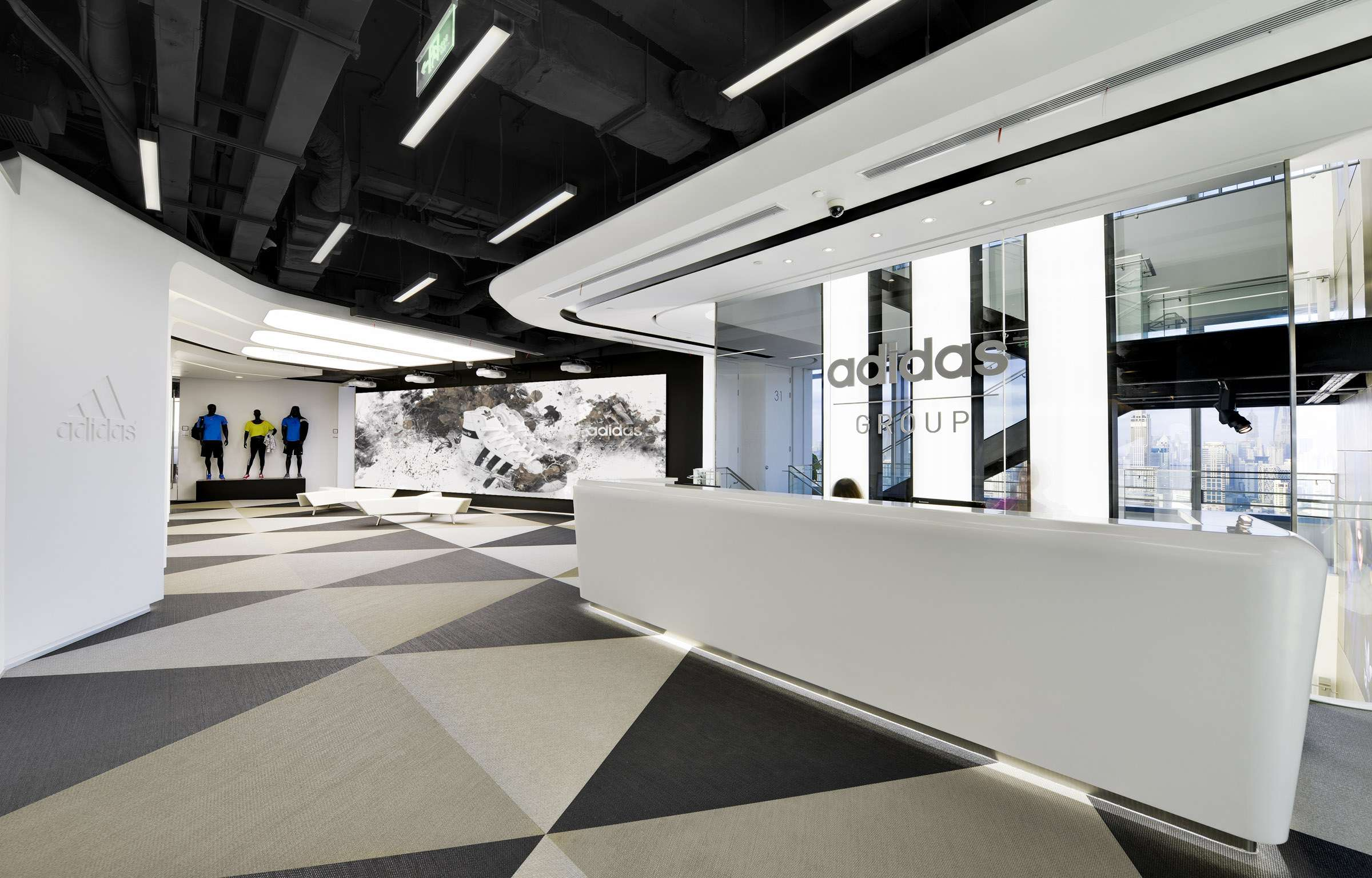 Triangle patterned woven vinyl flooring in the reception area at the office of Adidas in Shanghai, China