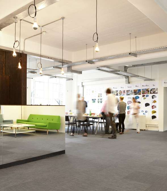 Grey Bolon floor tiles in the office of 18 Feet and Rising in London, UK