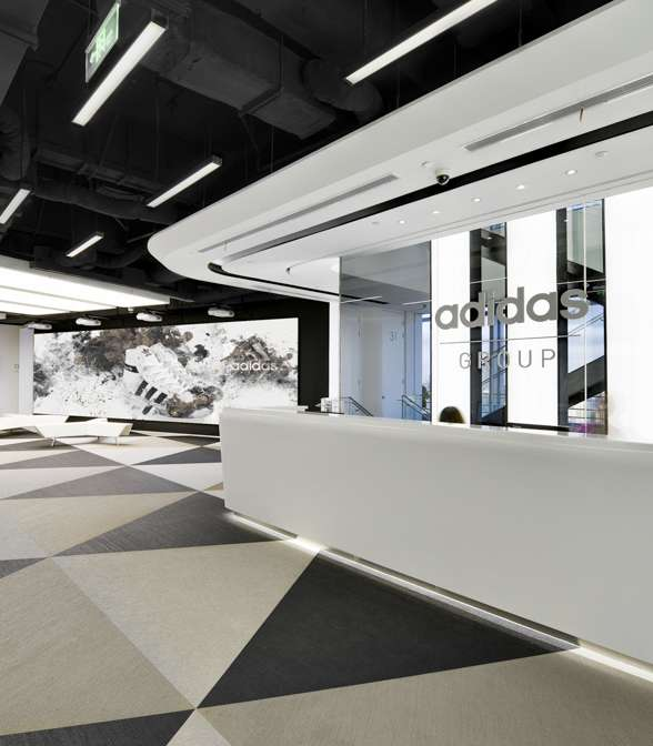 Black and white Bolon Studio Triangle tiles in the office of Adidas in Shanghai, China