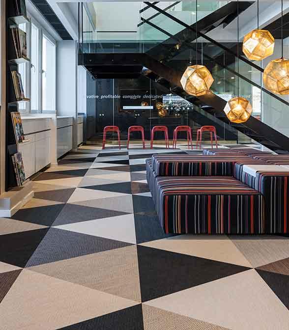 Geometrical floor pattern using Bolon Studio™ Triangle tiles in the office of Hoist in Stockholm, Sweden