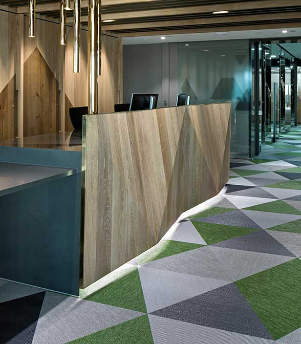 Grey, green, black and white flooring pattern using Bolon Studio™ tiles in the office of St George in Brisbane, Australia