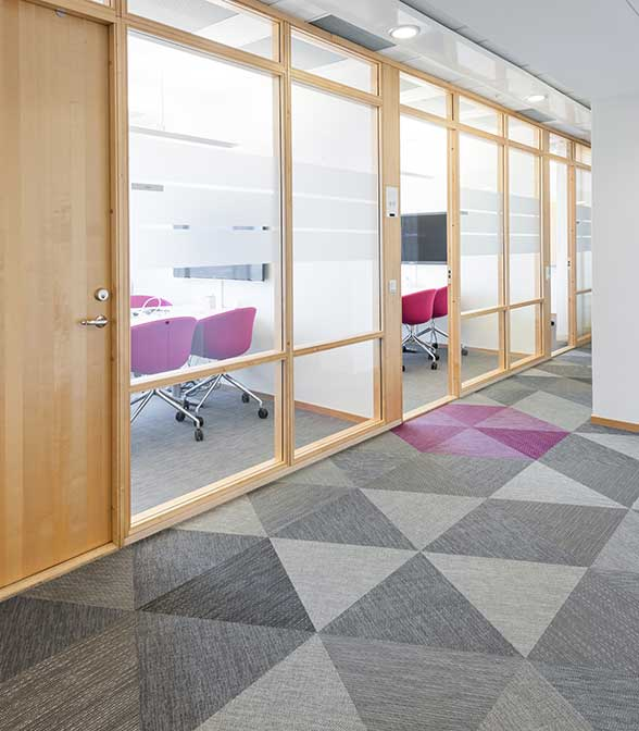 Geometrical floor pattern using Bolon Studio Triangle tiles in the office of Almi Invest in Stockholm, Sweden