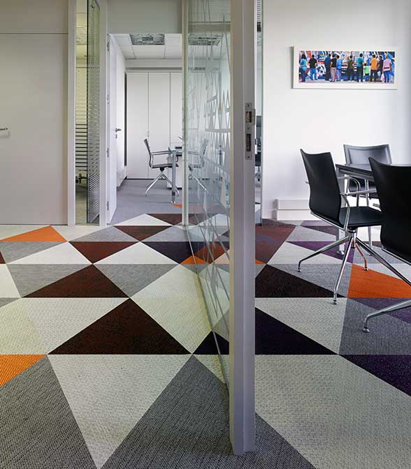 Playful flooring using Bolon Studio Triangle tiles in the office of Parada Y Cotelo Abogados in A Coruna, Spain