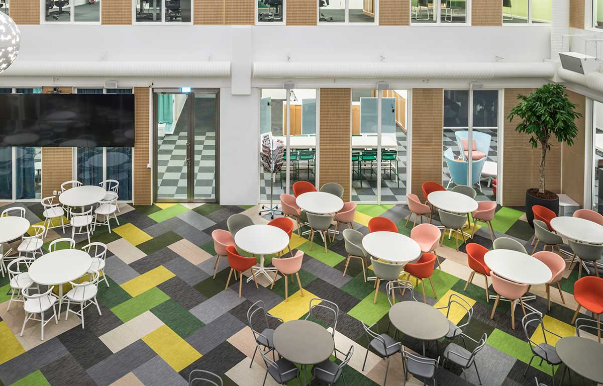 Green, yellow and grey Bolon flooring planks in the lounge area of SBAB's office in Stockholm, Sweden