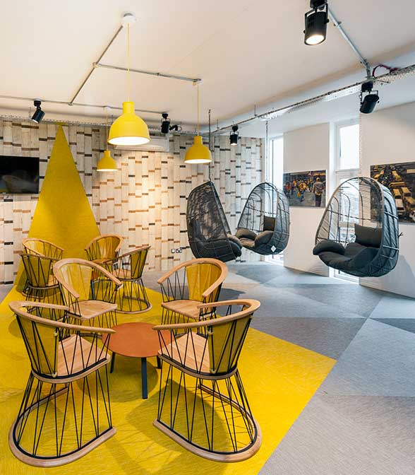 Grey and yellow woven vinyl flooring in the office of Nandos in Manchester, UK